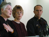 (DENVER, CO., OCTOBER 29, 2004)  Brenda Turner, victim of an attempted robbery, center, and Denver...