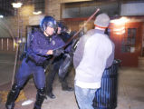 (BOULDER, October 31, 2004)  Police officers confront a person near the intersection of 13th...