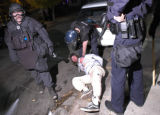 (BOULDER, October 31, 2004)  Police officers detain a person at 13th street and Pennsylvania...