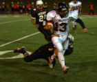 Aurora, Colo., photo taken October 29, 2004- Rangeview's Rick Berquist (#13) gains yards on a run...