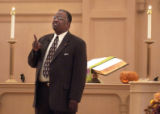 (Denver, Colo., October 31, 2004) Pastor Aaron Black gives a sermon on the responsibility of...