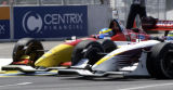 (DENVER, Colorado. August 15, 2004) Sebastien Bourdais in the far car and Bruno Junqueira get...
