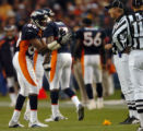 (DENVER, CO., OCTOBER 31, 2004) Denver Broncos' #80, Rod Smith, left, argues with an official...