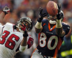 (DENVER, CO., OCTOBER 31, 2004) Denver Broncos' #80, Rod Smith, right, just misses a pass as...