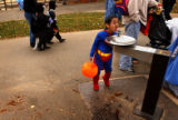Denver, Colo., photo taken October 31, 2004-Matthew Schantz,5, uses his super powers as he stands...