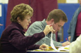 (CENTENNIAL, Colo., Nov. 2, 2004) Poll watcher Joan Beindorff and Edward Hay look through...