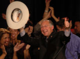 U.S. Senator-elect Ken Salazar tips his hat and flashes a thumbs-up to supporters after his...
