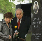 381701_0.tif. 6-9-03, 1B; Jane and Sylvester Sijan pause while unveiling a memorial to their son,...