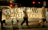 (11/08/2004) Boulder, Colorado-Laurie Herndon, Boulder, marches with a sign in protest of the Iraq...