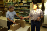 (Denver, Colo.11/4/04-- SEASON TO SHARE-Charles Muniz of Denver receives food from food bank...