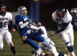 Broomfield, Colo., photo taken November 19. 2004- Broomfield's Kyle Kaiser (#8 blue) gets brougt...
