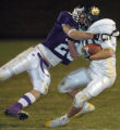 (ARVADA, CO., NOVEMBER 5, 2004) Arvada West's #22, Ian Mestdagh, left, tackles Bear Creek's #10,...
