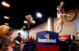 (DENVER, Colo.,  SHOT 11/5/2004)   Ripstoke team member Kevin Shiramizu (right) of Denver hops off...