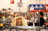 (DENVER, Colo.,  SHOT 11/5/2004)   Laura Chickering of Divide, Co. looks through some of the...