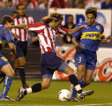 (Denver, Colo., July 21, 2004) Manuel Sol, of Chivas fights past Jose Calvo, of Club Atletico Boca...