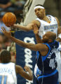 Denver, Colo., photo taken November 20, 2004- Denver Nugget forward, Kenyon Martin (white top)...