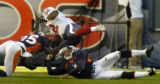 (Denver, Colo., November 7, 2004) Nick Ferguson, and kicker Mich Knorr tackle Jonathan Wells after...