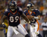 Denver Broncos Dwayne Carswell, #89, blocks for Broncos quarterback Jake Plummer, right, in the...