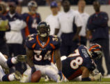 Denver Broncos Rueben Droughns, #34, shows disappointment in not gaining more yardage on a run in...