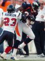 (DENVER., NOVEMBER 7, 2004)  Denver Broncos' #80, Rod Smith, right, makes record breaking 9-yard...