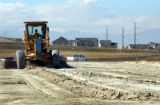 (AURORA, CO., OCTOBER 26, 2004) Construction workers prep the soil for further development at the...