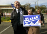 (Fort Morgan, Colo., Oct. 26, 2004) U.S. Senate candidate Ken Salazar walks and laughs with Morgan...
