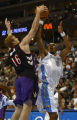 Denver, Colo., photo taken October 26, 2004-Denver Nugget guard, Rodney White (right) gets...