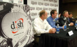 DX104 - Eric Sahl, vice president for EchoStar Communications, slaps Jim Martin, CEO of Altitude...