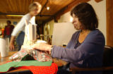 (DENVER, Colo., October 27, 2004) Cindy Gurule sews Christmas stockings, Wednesday Oct. 27, 2004...