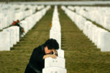 (DENVER, CO. NOVEMBER 11, 2004) Maeko Golus, Englewood, grieves at the grave of her husband, Army...