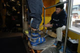 (KEYSTONE Colo., February 23, 2005)  Brett Morgan, of Surefoot -River Run Store - Keystone, checks...