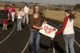 (ENGLEWOOD, Colo., February 14, 2005) As runners pass by on left of the frame, bake sale...