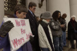 (DENVER, Colo., February 15, 2005) Betty Goebel, holding sign at left, listens with others as...