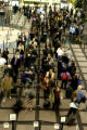 (DENVER Colo., February 15, 2005)  Airline passengers wait in security lines to pass through the...