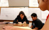 (DENVER. CO. FEBRUARY 15, 2005) Skinner Middle School Math Teacher Suzette Medrano works with...