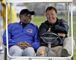 AZMG103 - Chicago Cubs manager Dusty Baker, left, and former player Ron Santo laugh at spring...