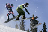 (COPPER MOUNTAIN, March 3, 2005) -(L-R) Nate Holland, Mark Schulz, and Ben Jacobellis fly off of a...