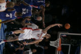 02/20/2005 Denver, Colorado-Houston's Yao Ming loses control of the ball after being blocked by...