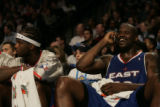 (DENVER, COLO.,  FEBRUARY 20, 2005) Eastern All-Star center, Shaquille O'Neal, talks on a cell...