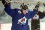 (CENTENNIAL, COLO., MAY 3, 2004)  Colorado Avalanche forward. Milan Hejduk stretches out his upper...