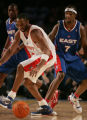 Denver 02/20/2005 ----  West's Kobe Bryant, #8, left, chases a ball knocked from him by East's...