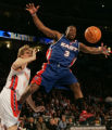 Denver 02/20/2005 ---- East's Dwyane Wade, #3, loses the ball against West's Dirk Nowitzki in the...
