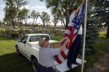 (BRUSH, Colo., May 30-31, 2004) Paul Eicher helps Stan, fellow VFW members, remove one of the more...