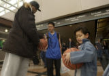 (Denver, COLO.  February 21, 2005) Atlanta Hawk basketball player Josh Smith, left, signs...
