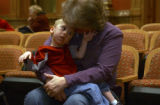 (DENVER, Colo., February 21, 2005) Micah DeSplinter,3, Aurora, gets a kiss on the forehead from...