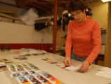 (BOULDER, Colo., February 22, 2005) Carol Owen works in her basement on a color palette for the...