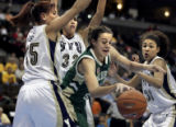 (DENVER shot on 3/9/05)   Colorado State's Lindsay Thomas (#45) tries to control the ball as...