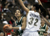 (DENVER shot on 3/9/05)   Colorado State's Melissa Dennett (#32) looks to shoot ariound Brigham...