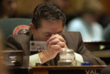 Denver, Colo.-February 23,2005- Re. Valentin Virgil  (D- Thornton) bows his head during a moment...