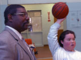 (DENVER, Colo., February 23, 2005) Principal Larry Tarver talks with Miko Bivens, right holding...